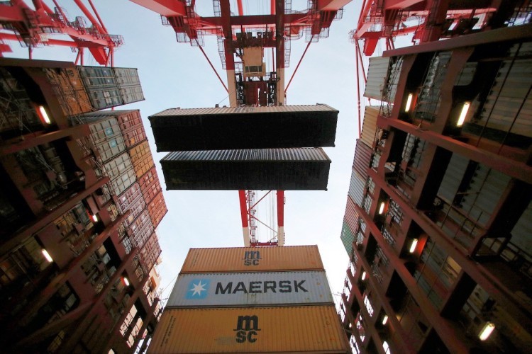 Containers are seen unloaded from the Maersk's Triple-E giant container ship Maersk Majestic, one of the world's largest container ships, at the Yangshan Deep Water Port, part of the Shanghai Free Trade Zone, in Shanghai